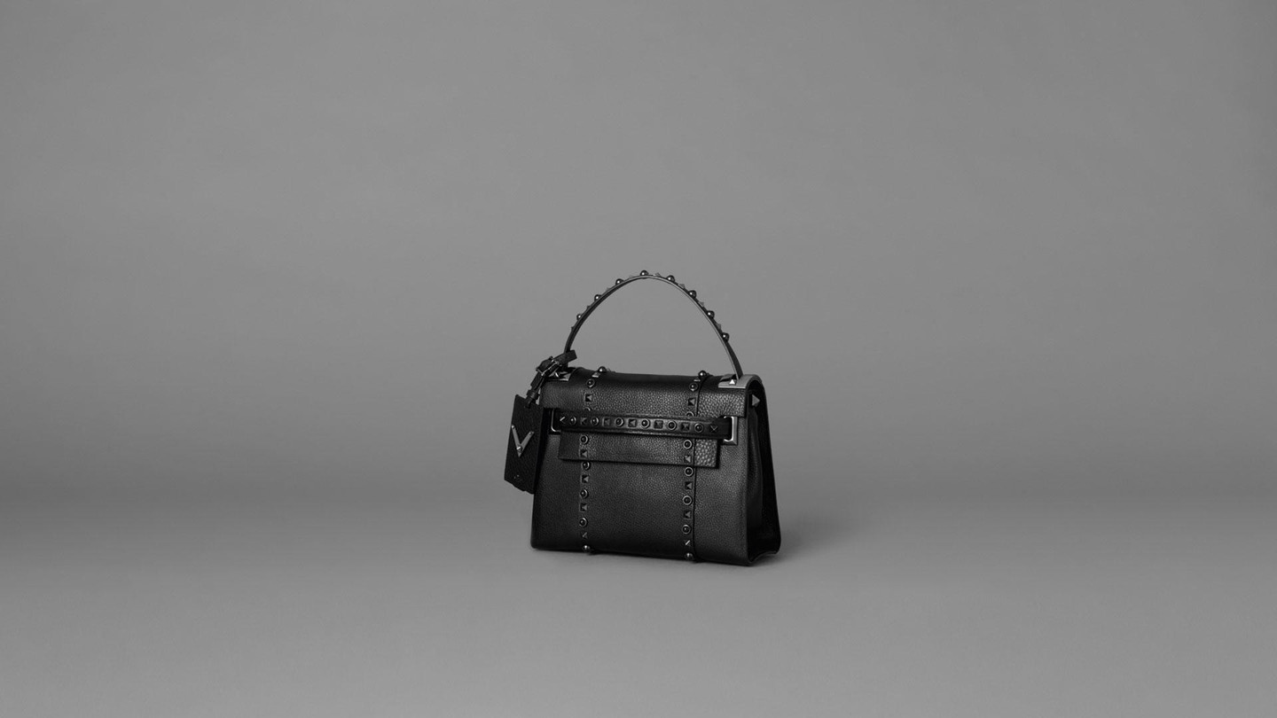 Valentino - Rockstud Rolling NoirThe eternal elegance of black on the most loved accessories of all timeShop the collection